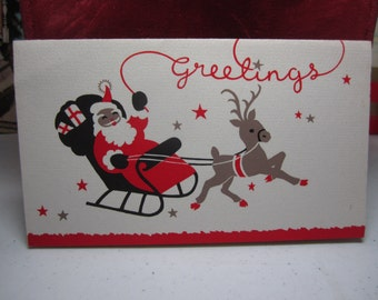 1940's-50's Burgoyne colorful christmas card santa claus in sleigh with one reindeer and waving from a red brick chimney inside