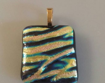 Beautiful one of a kind fused glass pendant waves