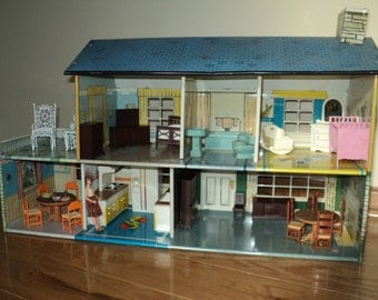 Vintage Metal Dollhouse in Very Good Condition with dollhouse furniture for each and every room with wonderful well developed patina