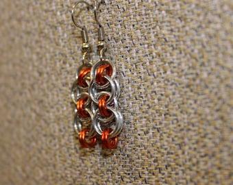 Orange helm earrings