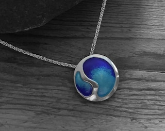 "Sterling silver and enamel pendant on an 18"" silver chain, in shades of blue enamel."