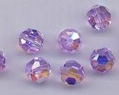 """Twelve """"out of program"""" Swarovski crystals: art 5000 - 8 mm - violet AB"""