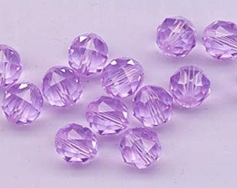 Twelve Swarovski crystals - art 5025 - 8 mm - violet