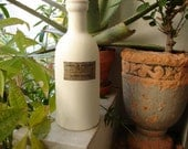 shabby chic,painted clay/ceramic ? bottle with old style apothecary label,essence of peppermint -10'' h.