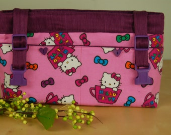 Powerchair-Walker Bag:  Bright Pink Hello Kitty Bag with purple lining.