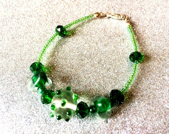 Emerald Green Glass and Crystal and Rocaille bead 7 inch Bracelet by JulieDeeleyJewellery on Etsy