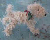 Champagne-coloured scruffy dog decoration.