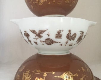 Americana nesting cinderella bowls, gold on brown