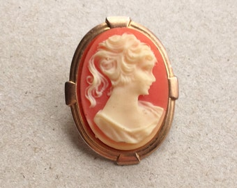 pretty and simple small oval vintage coral and cream cameo brooch in gold tone setting