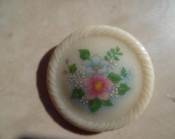 vintage Avon bakelite  floral  round pin  ....excellent condition..