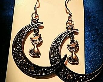 Silver kitties and black moons earrings