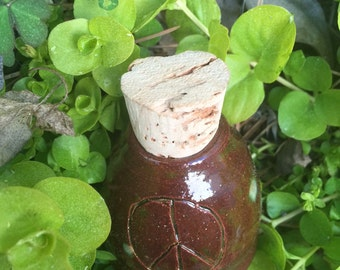 small brown stash jar, peace sign jar, herb jar. Stash jar, small jar, pottery jar