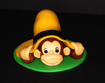 Curious George Under Hat with Bananas