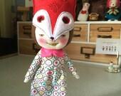 Handmade smiling doll wearing fox mask
