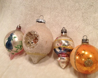 Four Vintage Christmas Indent Ornaments