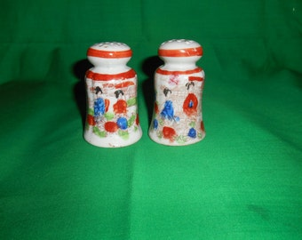 "One (1), 3 1/8"" Tall, Pair of Porcelain, Geisha Girl, Salt & Pepper Shakers."