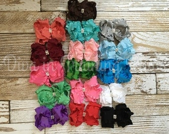 Ruffle bows  (multiple colors to choose from ) a little over 4in-4.5in on alligator clip.