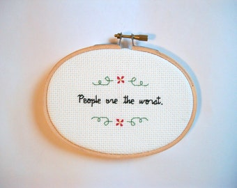 People are the worst cross stitch -- truth-telling, totally accurate completed 3x5 cross stitch about humans