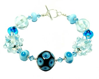 Featured brown and light blue lampwork bead bracelet, light blue bumpy beads, light blue Swarovski Crystals, Sterling Silver heart clasp