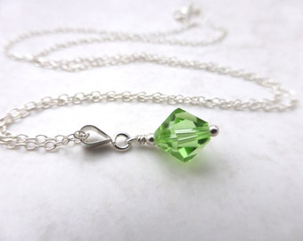 Green Peridot Swarovski crystal pendant. Peridot  and silver: Earrings and Pendant can be bought as a set.
