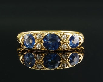 A superb Edwardian  triple natural sapphire and diamond ring