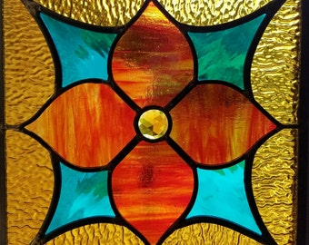 True North- stained, leaded glass panel; 12 inches square, red, teal, amber; unframed, ready to ship