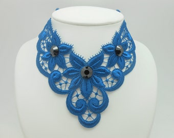 Blue necklace in blue guipure with crystal black stones of Swarovski