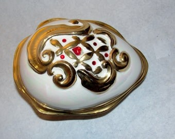 Porcelain Gold Painted Ostrich Egg Trinket Box Red Rhinestones and a Mother-of-Pearl Glaze Finish