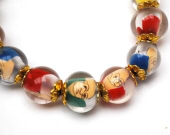 Vintage Lucite bead  Stretch Bracelet. Fun colorful Caricature man face vintage Beads mid century