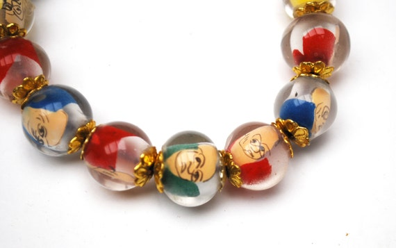 Vintage Lucite bead  Stretch Bracelet. - Fun colorful Caricature man face - Buddha  - vintage Beads mid century