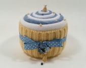 PINCUSHION... Yummy-looking Cupcake. Blue and white swirl with yellow. Polka dot ribbon. Metallic pins. Bead embellishments. Satin roses.
