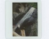 Clothed Figures Under Waterfall, Kodak Instant Film, c1980s Vintage Snapshot Photo  (65460)