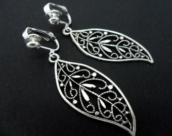 A pair of pretty tibetan silver leaf  dangly clip on  earrings.