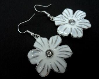 A pair of pretty hand made white enamel flower  earrings.