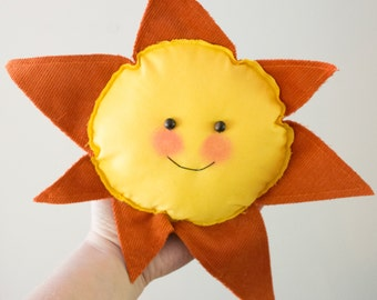 Smiley yellow and orange sun stuffed smiley wall decor