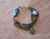 Night Ocean - Blue Moon Bracelet, Luminous Basha Beads and Bronze Dangle, 3 Strands Brass Chain, Boho Jewelry by hiddenfirepottery