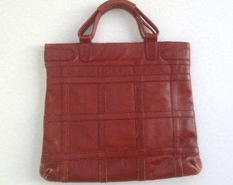 Distressed Leather satchel / 1970s retro leather purse / leather bookbag / top handles zipper closure / rust leather made in Columbia /