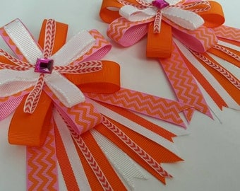 Horse show bows in bright pink, orange, and peach with chevron print and bling