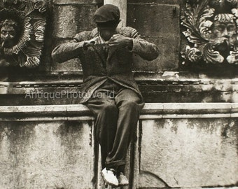 Man cleaning nails vintage photo by S. Levinsohn