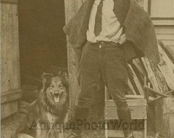 Man smoking cigar posing with Collie dog antique photo
