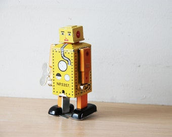 Vintage robot toy, tin robot wind up toy in yellow, collectible, walking robot toy, Chinese, robot clockwork toy, late eighties