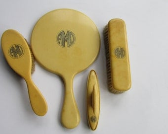 Vintage Dresser set Pyralin Celluloid Monogramed AMD Mirror Two Brushes and Nail buffer