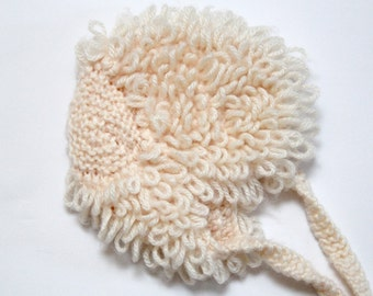 Vintage cream looped wool baby hat with knitted ribbon