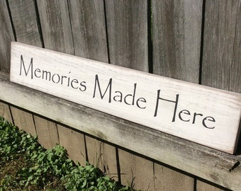 "Wooden, Handmade, Long Sign. ""Memories Made Here"". Great sign for your home. Gift giving at its best. Family, friends, neighbors. Antiqued."
