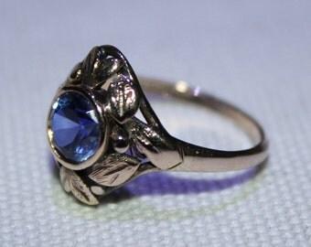9ct rose gold blue paste dress ring