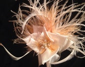 Ostrich feather flower fascinator with  biot feathers and pearl bead accent ivory gold white