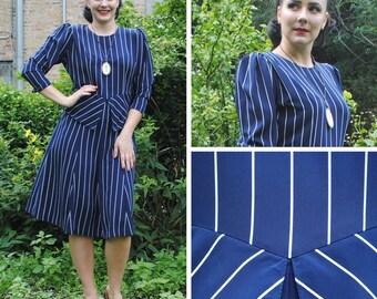 Striped Navy Peplum Dress
