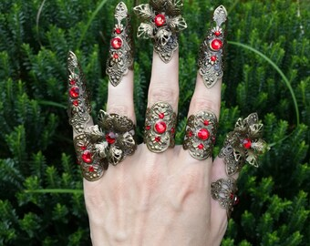 Red rhinestones claw spike filigree nail fingers with flower detail