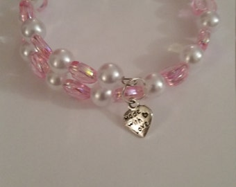 Pink hearts with white pearl beads. Bracelet