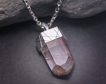 Talisman series No 4. Texturized sterling silver and natural rutilated quartz point.